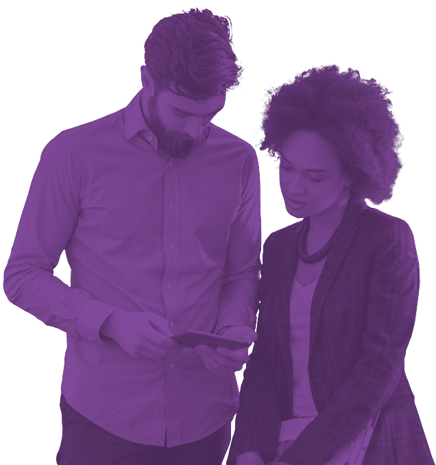 Photo of man and woman looking at a tablet together