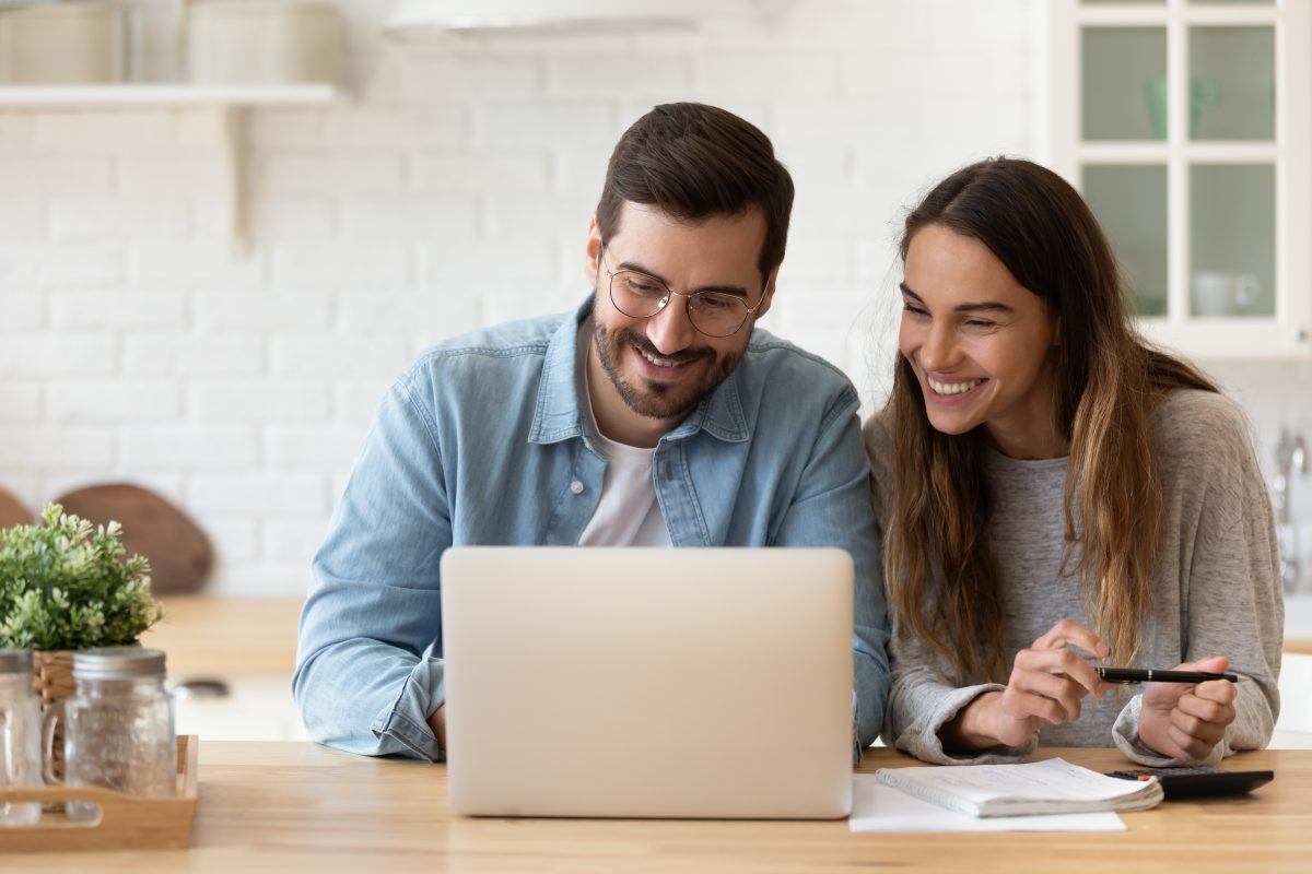 young-couple-on-laptop-at-home