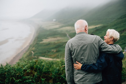 Older couple over scenery - Educators Financial Group