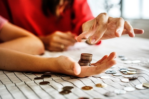 Educators Investing - pairs of hands with coins