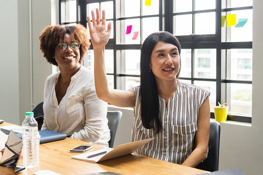 Woman raising hand - Educators Financial Group