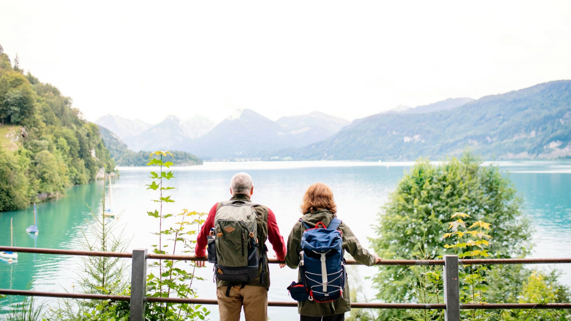 retired-man-and-woman-travelling-world-sightseeing-mountains