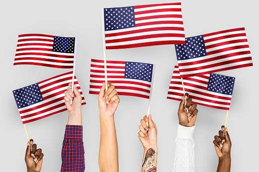 U.S. flags held by hand - Educators Financial Group