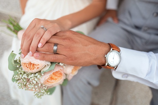 Two hands in wedding - Educators Financial Group