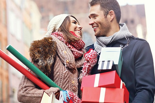 Couple with red and green gifts - Educators Financial Group