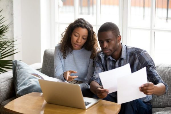 man-woman-computer-reviewing-bills